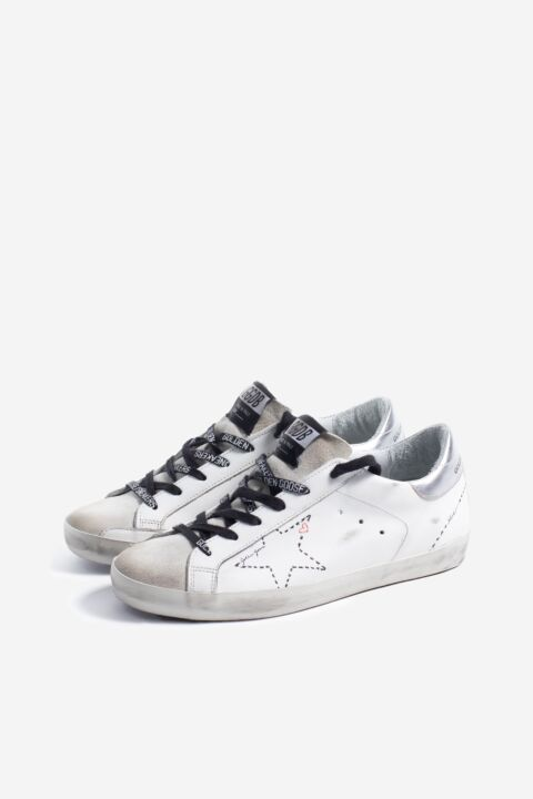 White/silver low top sneakers